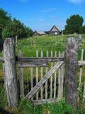 Puerta de la cerca de la aldea Foto de archivo libre de regalías