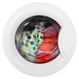 Puerta de la lavadora con la ropa giratoria Imagen de archivo