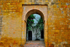 Puerta de la muralla. Wall´s door,inside contain a orange tree,outside that´s a pool´s of defense Stock Images