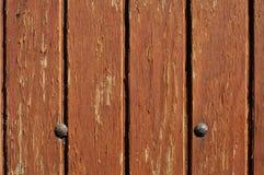 puerta de madera con dos clavos Fotografía de archivo libre de regalías