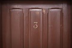 Puerta de madera del número tres Fotos de archivo libres de regalías