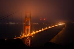 Puerta de oro en la oscuridad Foto de archivo