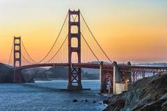 Puerta de oro en la puesta del sol Imagen de archivo libre de regalías