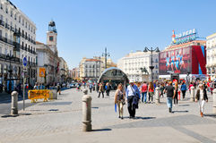 Puerta de Sol in Madrid, Spain. Madrid, Spain - April 10, 2016: Tourists visit Puerta del Sol, a major public square in Madrid, Spain Royalty Free Stock Images