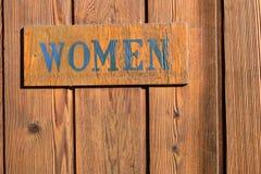 Puerta del cuarto de baño de la muestra de las mujeres Fotografía de archivo