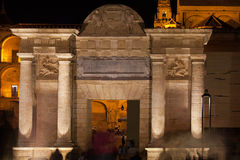 Puerta del Puente at Night in Cordoba Stock Photo