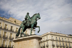 Puerta del Sol, Madrid. The equestrian statue of King Carlos III in the Puerta del Sol square in Madrid Stock Photos