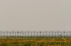 Puerta en la cerca With Cloudy Sky Fotografía de archivo libre de regalías
