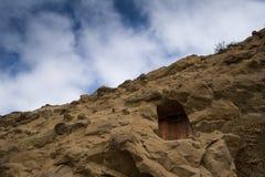 Puerta en una roca Foto de archivo libre de regalías