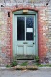 Puerta principal abandonada de la casa Fotografía de archivo libre de regalías