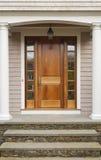 Puerta principal con el pórtico Fotos de archivo