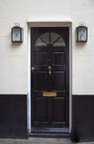 Puerta principal negra Foto de archivo libre de regalías