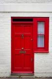 Puerta principal roja Imagen de archivo libre de regalías
