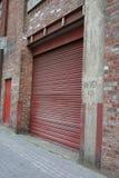 Puerta roja del rodillo Imagen de archivo