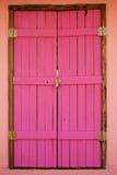 Puerta rosada de madera Fotografía de archivo