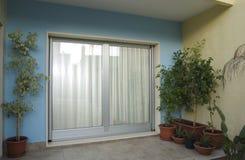 Puerta-ventana imagenes de archivo