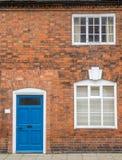 Puerta, ventanas y pared para el fondo Foto de archivo libre de regalías