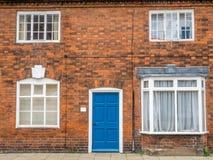 Puerta, ventanas y pared para el fondo Imagen de archivo