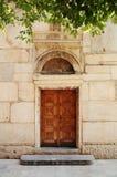 Puerta vieja a la iglesia Imagen de archivo libre de regalías
