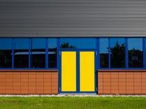 Puertas amarillas y azules Imágenes de archivo libres de regalías