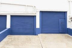 Puertas azules del almacenamiento Fotografía de archivo libre de regalías