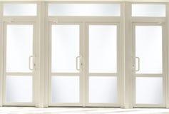 Puertas de entrada plásticas con el vidrio Imagen de archivo libre de regalías