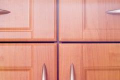 Puertas de madera del armario de la cocina Fotografía de archivo libre de regalías