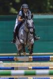 Puertas femeninas de Jumpimg del caballo Imagenes de archivo