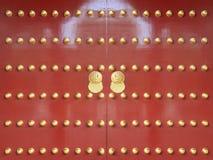Puertas rojas con la pintura de oro 2 Imagen de archivo libre de regalías