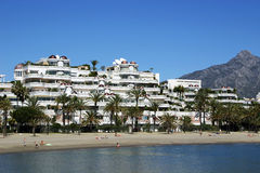 Puerto Banus beach Spain. Puerto Banus beach and holiday apartments Spain Royalty Free Stock Photos