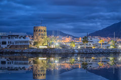 Puerto Banus at dusk in Marbella. Tower in Puerto Banus at dusk in Marbella, Andalusia, Spain royalty free stock photography