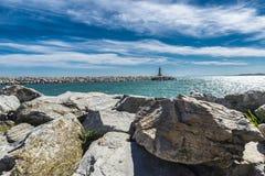 Puerto Banus, Marbella, Spain. Stone lighthouse at the end of pier in Puerto Banus, Marbella, Spain stock photography
