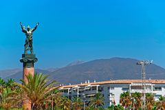 Puerto Banus, Spain - August 22, 2010: Victory Statue of a man in Puerto Banus, Spain. Puerto Banus, Spain - August 22, 2010: Victory Statue of a man in Puerto stock image