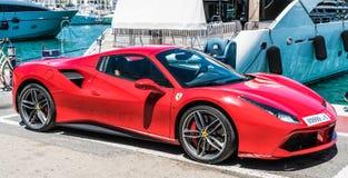 Red ferrari in the harbour stock photos