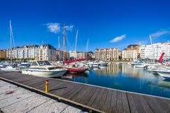 Puerto Chico sailing port in Santander Cantabria, Spain. Recreational port with motor and sailing boats. Partial view of the city royalty free stock photos