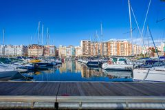 Puerto Chico sailing port in Santander Cantabria, Spain. Recreational port with motor and sailing boats. Partial view of the cit. Y stock image