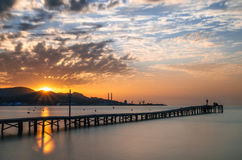 Puerto de Alcudia beach pier at sunrise in Mallorca, Balearic is. Majorca Puerto de Alcudia beach pier at sunrise in Alcudia bay in Mallorca Balearic islands of Royalty Free Stock Images