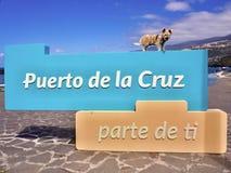 Puerto de la Cruz parte de ti a part of you slogan with a little dog above. Puerto de la Cruz, a city on the island of Tenerife advertises the slogan: Puerto de stock photos
