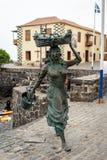 Sculpture `Fisherwoman` by artist Julio Nieto on the Playa del Muelle. PUERTO DE LA CRUZ, SPAIN - JULY 19, 2018: Sculpture `Fisherwoman` by artist Julio Nieto royalty free stock photo