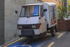 Piaggio Ape parked on steep hill in Puerto de la Cruz royalty free stock image