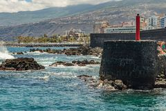 Puerto de la Cruz, Tenerife, Spain - July 10, 2019: . The Old port of town is a popular tourist attraction and favorite place for royalty free stock images