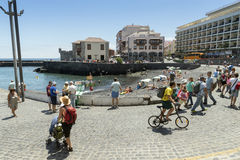Puerto de la Cruz. TENERIFE, SPAIN - JUNE 20, 2015: the people enjoys a sunny summer day in the old fishing port Royalty Free Stock Photos