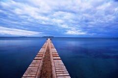 Puerto de madera en la playa de Noume Imagen de archivo libre de regalías