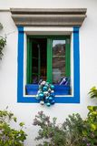 Puerto de Mogan, Gran Canaria in Spain - December 16, 2017: Window in a restaurant with blue and silver christmas Stock Photography