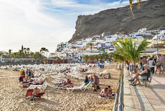 Puerto de Mogan, Spain – January 17, 2016: People at the beach enjoying resort Puerto de Mogan. Gran Canaria, Canary islands. Royalty Free Stock Photo