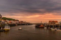 Puerto de Whitby - salida del sol Foto de archivo libre de regalías