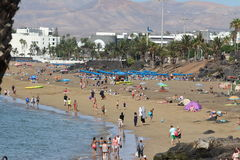 Puerto del  Carmen beach, at Lanzarote. A busy Puerto del Carmen beach  almost all year round with the warm winters and hot summers Royalty Free Stock Images