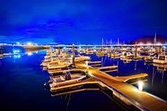 Puerto deportivo en la noche con los yates amarrados Fotografía de archivo libre de regalías