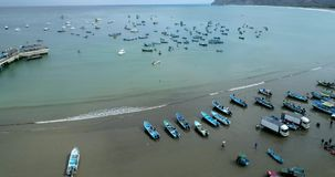 Puerto Lopez, Ecuador - 20180913 - Drone Aerial - Drone Rises, Revealing Bay Filled With Fishing Boats. Puerto Lopez, Ecuador - 20180913 - Drone Aerial - Drone stock video footage