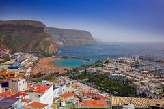 Puerto Mogan, Gran Canaria, Holiday in Canary Island, Spain, Europe. Small town on the south coast. Summer in Puerto Mogan, blue s. Ky stock image